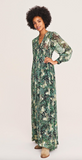 This delicate floaty dress is so pretty on you'll want to wear it and wear it.  Crafted from a lightweight flowing fabric with a slight shimmery effect this maxi ticks all our boxes.  In a beautiful green print with transparent long sleeves, a pretty v neckline and smocked panel at the waist this is a beautiful feminine dress.