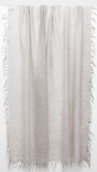Hand crafted luxury from our favourite new cashmere brand Kinross.  Pure, natural, soft and sophisticated Kinross create timeless pieces that you will wear and love forever.    This beautiful taupe 100% cashmere scarf is scrumptiously soft and with a delicate fringed edging this is just want you want to wrap around yourself for a bit of extra warmth!