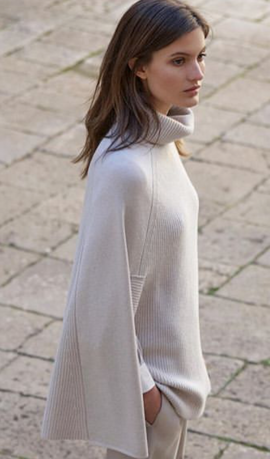 Stunning cashmere and wool blend poncho from Amina Rubinacci.  Giving a lovely slim silhouette and in a beautiful pale grey colour put this on and you will immediately feel effortlessly finished.