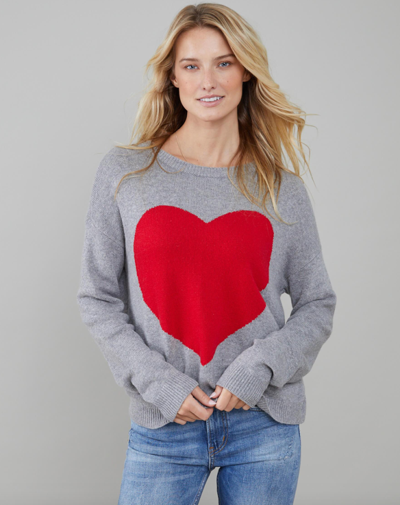 Super soft crew neck relaxed jumper from South Parade with a great big red heart on it!  Sure to put a spring in your step and a smile on your face pair with your favourite denim for a very happy outfit.