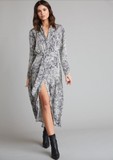 Easy to wear shirt dress from Bella Dahl in a snakeskin print.  Crafted from Bella Dahl's signature soft fabric this is sure to turn heads.  With long sleeves and an adjustable waist tie to cinch in for added shape pair this with boots or trainers and you're ready for your evening.