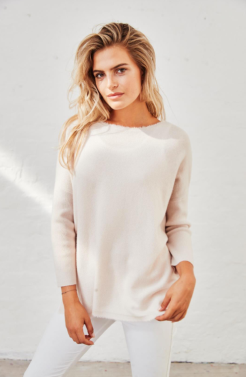 Our new absolute favourite jumper.  Crafted from Henry Christ's signature softest ever cashmere in a classic soft white to put this on is to fall in love with it.  With a flattering slim sleeve and the perfect length hem to go with all your skinny denim we guarantee you'll love this.