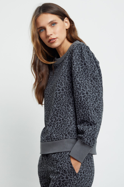 Super soft charcoal grey crewneck sweatshirt in a pretty cheetah print.  Featuring a straight fit, rib detail at the neckline, hem and cuffs and a pleated puff detail at the shoulders this is as feminine as a sweatshirt can be.  Pair with the matching Kingston Sweatpant in the same print and you will be incredibly comfortable and stylish at the same time!
