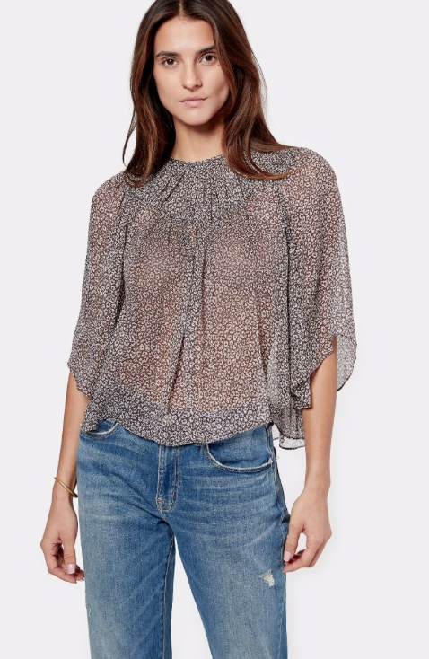 Gorgeous floaty semi-sheer top from Joie.  With bell sleeves, a high neck and relaxed fit this looks perfect paired with your favourite boyfriend jean to create a feminine tomboy look.