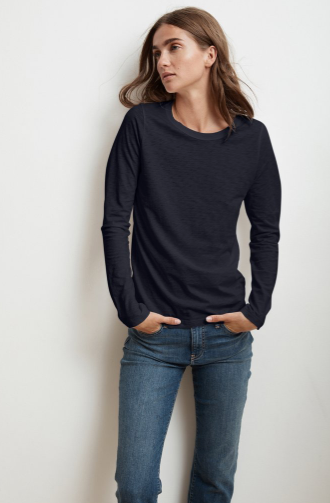 The perfect long sleeved tee from Velvet by Graham & Spencer.  Crafted from their signature super soft whisper soft cotton slub this is a great tee on it's own and equally great for layering.  Flawless fit and featuring a contrast band around the neckline and hemline that hits the hips in just the right spot.  You'll want this in every colour.