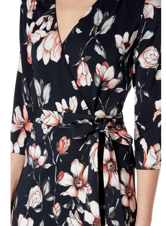 Ultimately flattering fit and flare wrap dress from Goat in the gorgeous new hand painted magnolia print on a dark navy background.