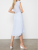 Lightweight linen, striped midi-length wrap dress with cap sleeves, soft ruffle at neckline, and high-low double layered skirt. A feminine yet effortless fit, perfect for whatever your day has in store.