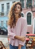 Lightweight linen, wrist-length peasant sleeve, V-neck button-down top with adjustable self-tie drawstring waist. Features delicate sheering detail at neckline and sleeves to create a billowy romantic effect.
