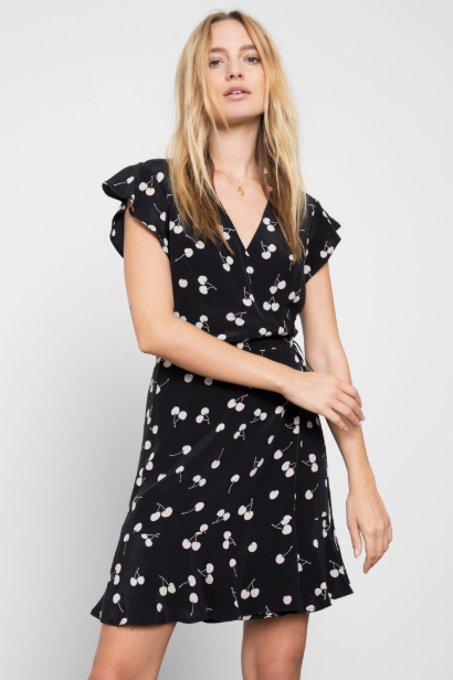 Short flutter sleeve, 100% silk, functional wrap dress with flounce bottom hem. Sleek with clean lines, yet still cute and fun featuring a cream cherry print.