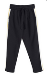 Inspired by retro sportswear shapes, these slightly cropped black Dreamer track pants deserve a place in your off-duty wardrobe. Made from comfy cotton in a classic slim fit, they feature rainbow-knitted tape down the legs for a touch of lively colour. Team with your slogan T-shirt of choice for a cool, comfortable weekend look.