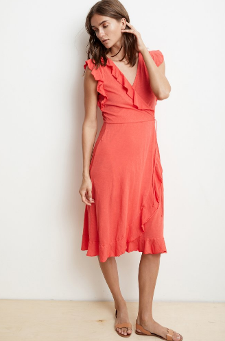 Wrap star.  Here's the perfect dress that is just right for Spring.  Crafted from our soft cotton slub, which has a hint of sheer and a heathered texture, this just below the knee beauty features a wrap silhouette with a tie at the side waist, as well as a chic ruffle on the sleeves and neckline.  Easy and amazing from Velvet.