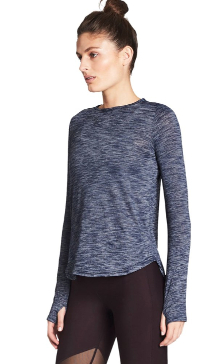 Warm up, cool down or sweat it out in this versatile sweat-wicking layer from Nimble.