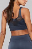 The Grayson Bra combines our soft, seamless fabric with compression that moulds to your body for effortless comfort and natural range of motion. This style features perforated mesh for elevated style and increased ventilation. Non-padded.