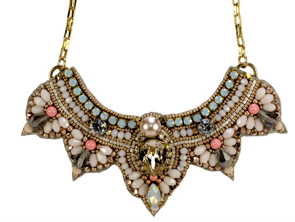 Stunning statement necklace with Swarovski crystals, Japanese glass beads, Pearls and a gold plated chain. This beautiful design is hand embroidered and fastened with a gold plated lobster clasp.