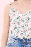 Tiny ruffles ripple along the sweetheart neckline of this silk tank.