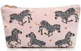 This fun and luxurious zebra pouch design was inspired by Elizabeth's trip to Kenya for her honeymoon. Elizabeth who has been illustrating since she was little, drew the design based on the dazzles of zebras she encountered on her trip. Ever inspired by the dusty pink skyline, she chose to pair them with a soft velvety base and detail their markings with gold thread to show the sun's reflection on their silhouettes as they dance into the sunset. This pouch is perfect for storing your holiday essentials, ide