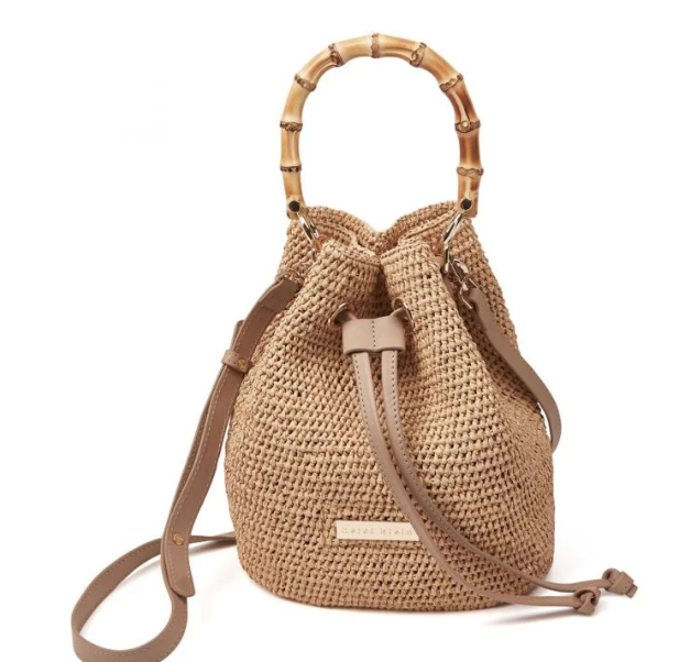 A versitile mini sized bag providing, practicality sophistication and style from handwoven and handcrafted natural materials. One internal open pocket