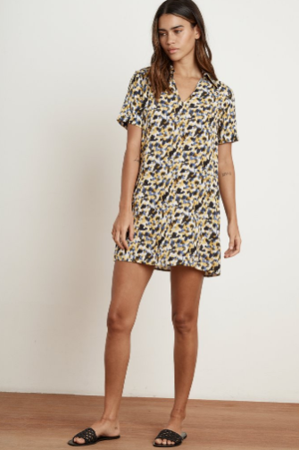Shirting the issue!  Crafted from Velvet's luxe and lightweight woven challis, this mini dress is the epitome of pop on and go.  With a slight a-line to the silhouette, v-neckline with pointed collar and slash pockets at the hip, it's short, sharp and oh so easy!