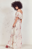 Our Evelyn Dress flows to the floor in contrast-colored silk georgette with a hand-painted bouquet motif. The elastic neckline with a raw edge is adorned with a 70s-inspired cascading cape ruffle, resting on or off the shoulder and forming flutter sleeves. The dress can be worn several ways, including forward or backward, making all kinds of dreams come true. Ships with belt as shown. Shown here in Multi.