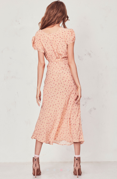 Our Meg Midi Dress radiates romance in washed silk crepe with a vintage-inspired tea rose print. This modern take on an old-fashioned country frock features a small ruffle detail that extends from the trimmed v-neck to classic puffed cap sleeves on each side. An easy fit skirt falls to mid-calf. Shown here in Sardinia.  **Please note the belt is not included with this dress