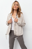 Lightweight, heavy Tencel long sleeve jacket with zipper and snap closures, and drawstring hem with toggles. This easy to layer, throw on and go style also features military-inspired details such as epaulets, back flap, and cargo chest pockets. This top selling jacket is back in a must-have neutral bone color that pairs well with almost any outfit.