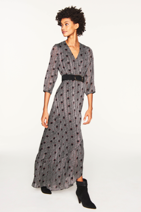 This gorgeous maxi dress from ba&sh will make you feel feminine even when paired with a biker boot.  The dress features a wrap around skirt, a ruffle hem and 3/4 length sleeves and is delicately embellished with a metallic thread.