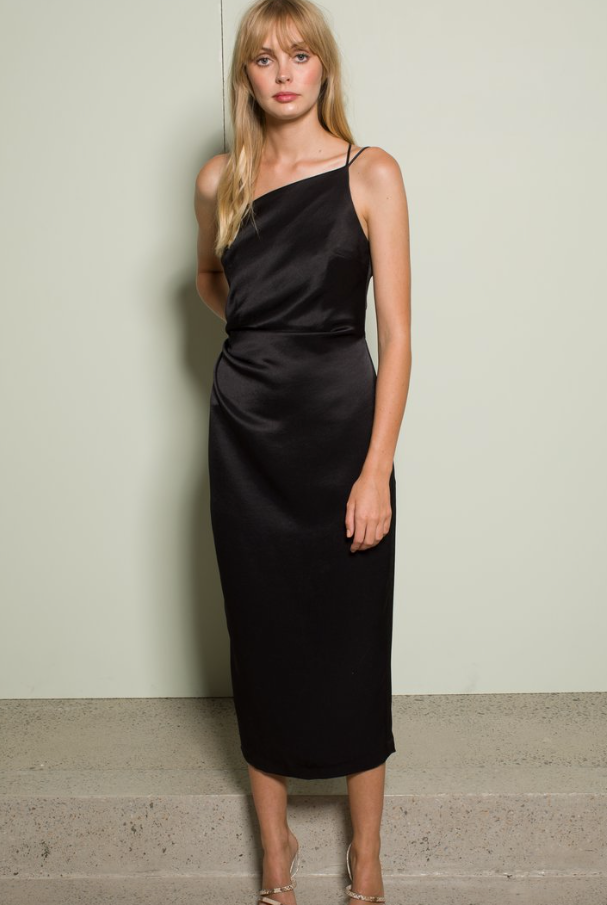 Look no further for your next lbd.  This gorgeous asymmetrical black number has a tuck detail, double strap over your left shoulder and a unique back that is sure to turn heads.