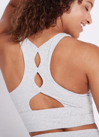 This mid intensity support Back in Action White Sports Bra has comfortable four way stretch and a very flattering back detail that sits flatly on your back.  The bra has removable padding and is created from a nylon/polyester/spandex mix that feels gentle like cotton and works hard to meet your technical requirements - it will move with you whilst still supporting you.  Shown here in a gorgeous white and black print it will look equally great with the matching leggings or simple black leggings.