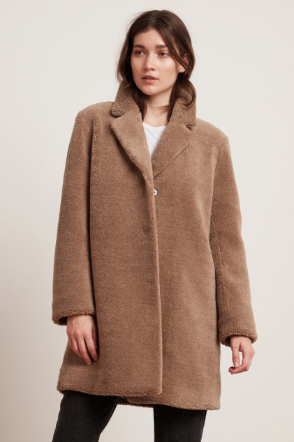 This eco friendly faux sherpa oversized coat will keep you warm and cozy throughout the winter months!  The coat is fully lined and has a collar that can easily be turned up to keep you extra toasty.  As is oversized can be worn over your extra big wooly jumpers as well.  Featured in a nice neutral tan colour this will match just about anything you would like to put with it.