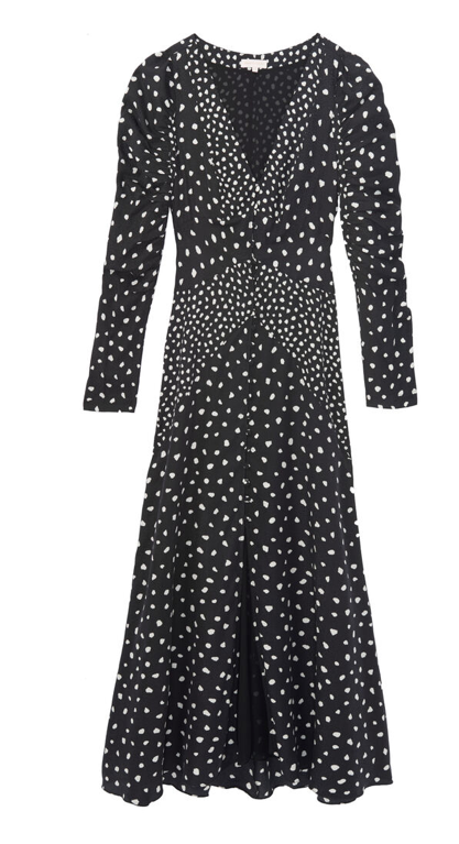 This Black Dress with it's dual scale dot print creates a lovely defined waist.  The dress evokes memories of pretty vintage style dresses, with the gathered sleeves and below the knee hemline whilst creating a modern look with the button from deep v-neck.  The silky soft silk and viscose blend fabric means the dress moves beautifully when you're walking or dancing!