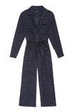 his is a jumpsuit with a difference.  Made from a super soft silk alternative rayon in a charcoal tiger stripe print and featuring wide legs and a nipped in elastic waist for easy access you can dress this up elegantly with a heel or dress it down with a trainer.  The fabric drapes beautifully and will flatter most shapes.