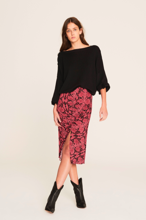 This is an ultra feminine skirt - with it's midi length, perfect slit, gathered elastic along the centre front for shape and in a pretty pink animal print.  Pair with a black jumper or a tee depending on your mood.