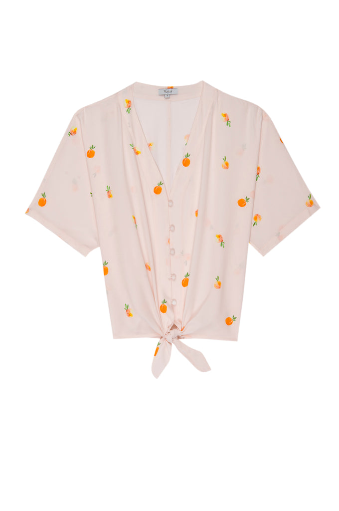 Short sleeve, cropped, linen top with tie-front in a fun peach print.