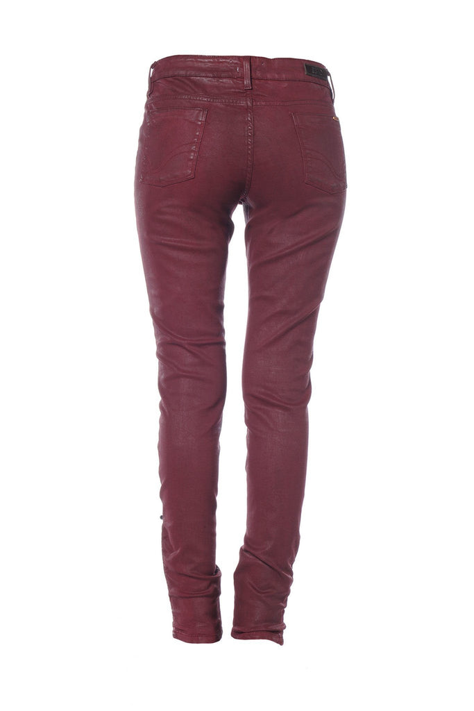 Rear view of burgundy red wax sheen jeans by Reiko at Peek Boutique