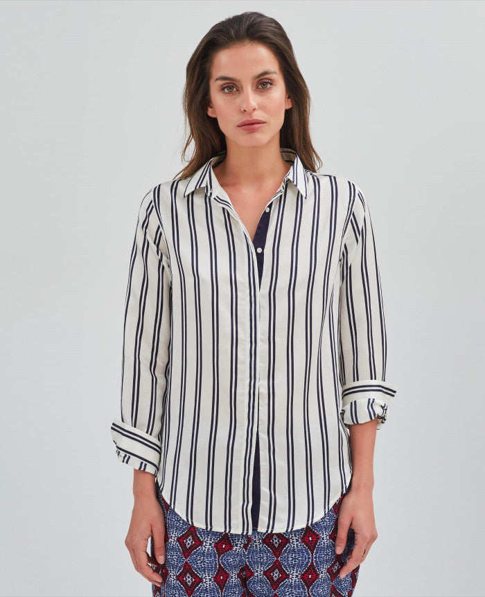 Smart fitted cotton & silk navy and off white striped shirt with front button closure and a longer back.  65% cotton 35% silk.