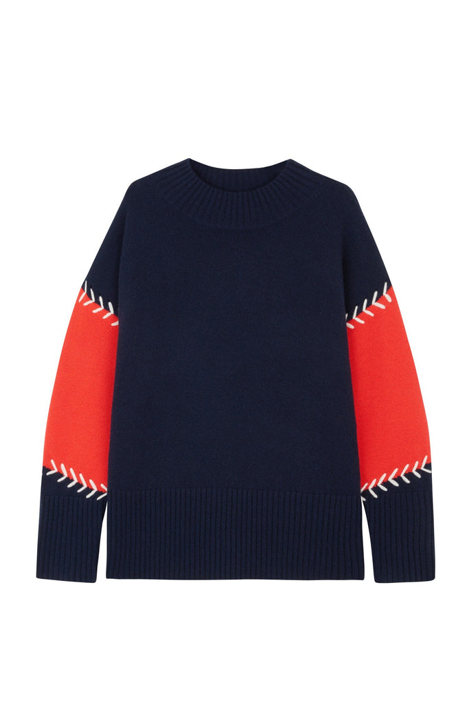 This chunky navy sweater is crafted from a blend of wool and cashmere to an oversized shape with a cosy high neck. The contrasting red sleeve panels are outlined with crafty white chevron stitching.