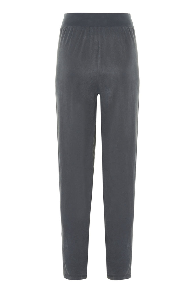 Rear view of women's relaxed charcoal trousers by Gestuz at Peek Boutique