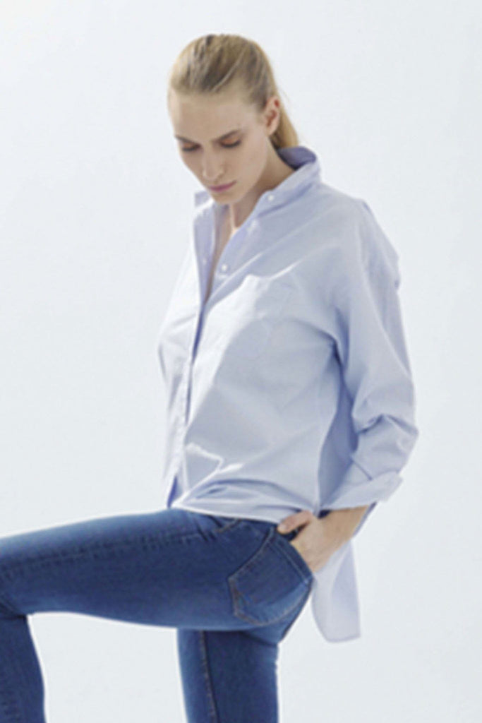 Women's pastel blue formal shirt by Artigiano at Peek Boutique