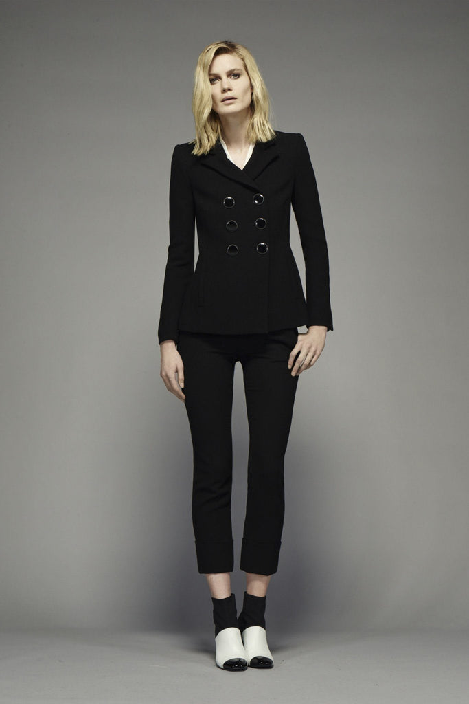 Women's black 100% wool crepe tailored trousers with fold up bottoms, branded Goat available at Peek Boutique