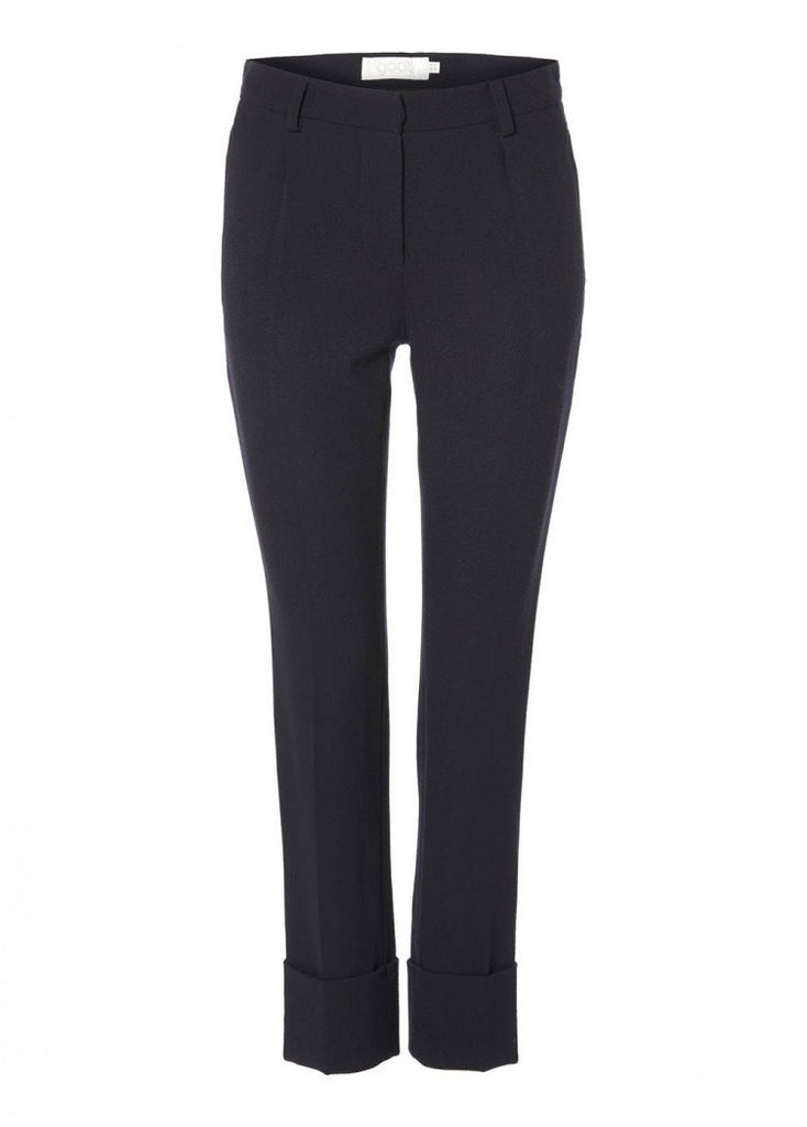The Cooper trousers are contemporary, versatile and chic. The trousers have a slim fitting leg and deep turn-ups. Perfect for dressing down with flats or up with heels.