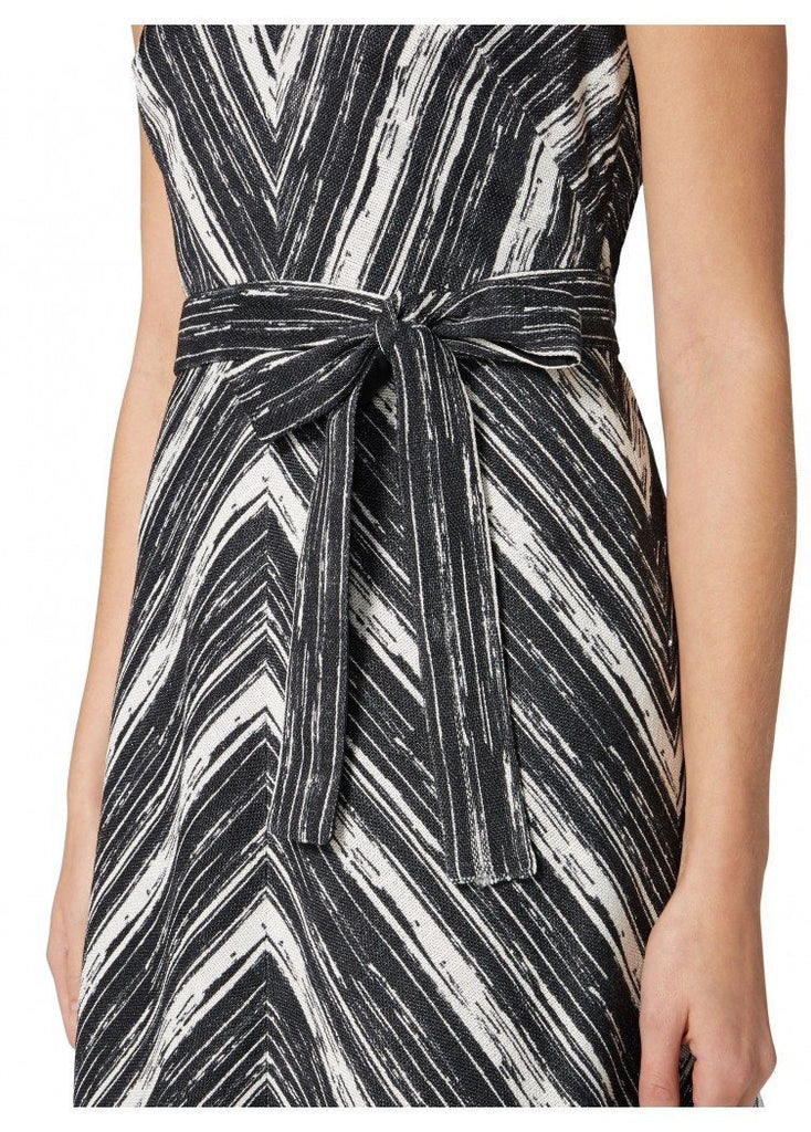 The Demetrius V neckline fit & flare sleeveless dress with sash belt is a perfect investment piece to transition in to spring/ summer. The flattering monochrome stripe print makes a sophisticated yet bold fashion statement and works for an social occasion. Pair with black heels for the evening and silver flats for the daytime. - 100% Viscose  Lining - 100% Cotton