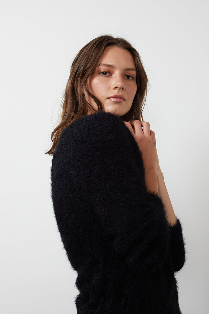 Say hello to Elle!  The perfect scrumptiously soft jumper in always wearable black.  This will pair beautifully with your midi skirts, your favourite denim or your jammies!