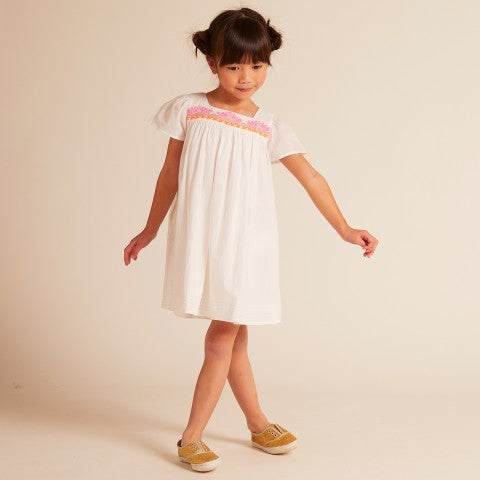 Wild & Gorgeous Budapest dress white Deliciously crisp and fresh white cotton dress with electric pink and orange embroidered detail and lightly scattered gold sequins.
