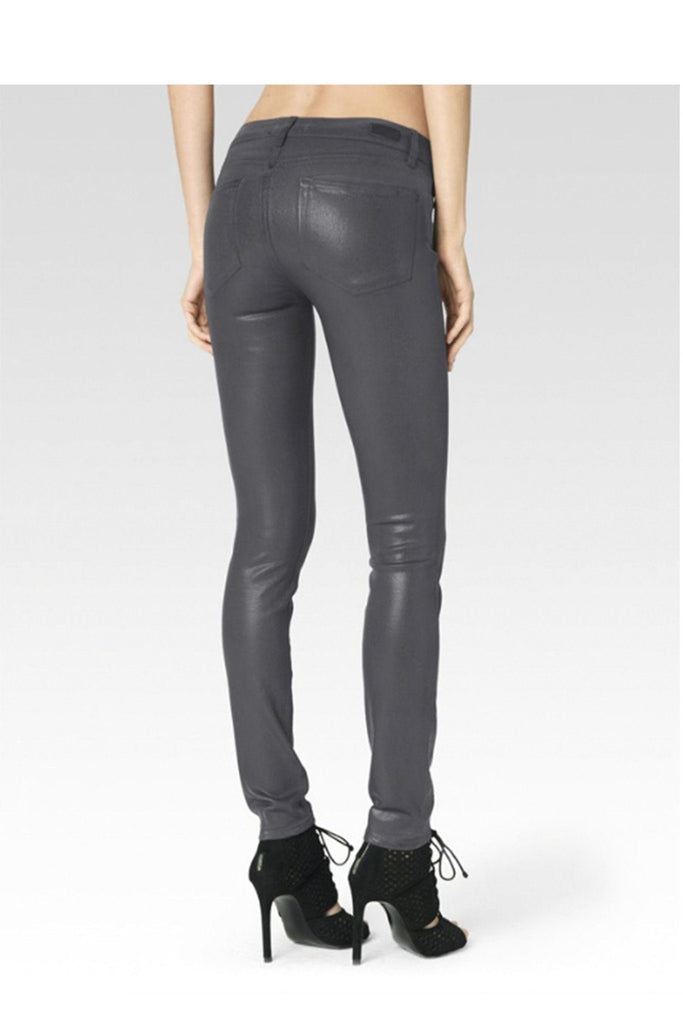 Paige's beloved ultra skinny Verdugo Jean receives a fall-ready rocker update which combines the brand's transcend fiber technology with a super gloss pigment that combines the look of leather with a silhouette that you can live in. The mid-rise Verdugo sits at the waist and fits through the hip, thigh and ankle for a true skinny fit. This denim is crafted with the luxe, grey coating for a sleek look and true, rocker style.  52% Rayon 26% Cotton 18% Polyester 1% Spandex