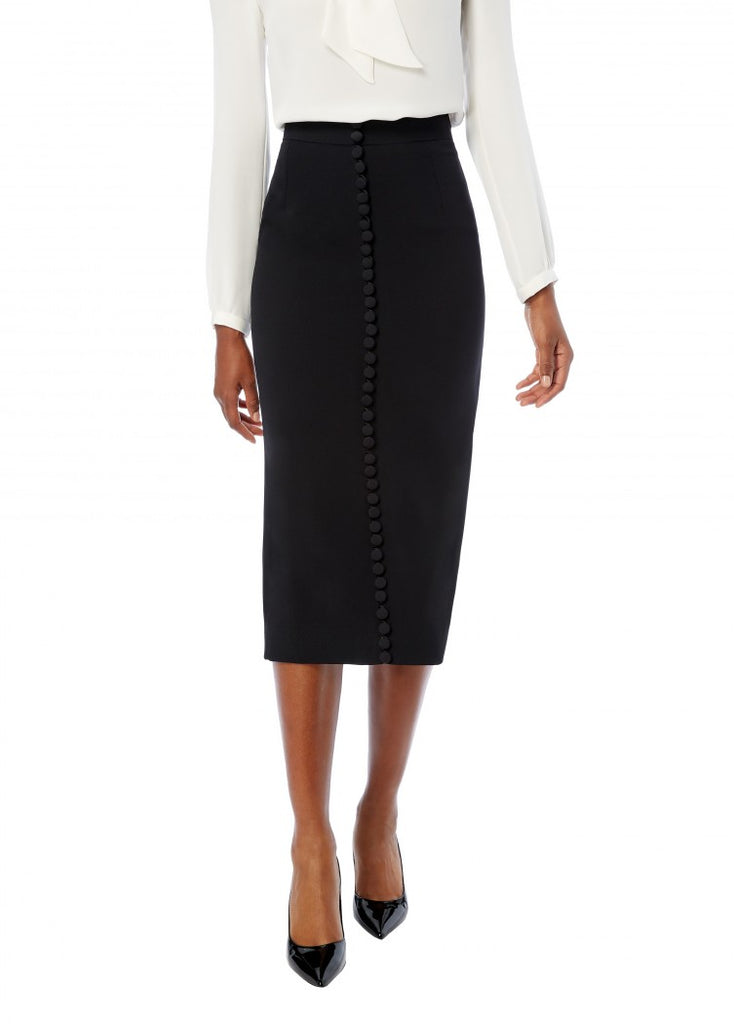 Gorgeous fitted pencil skirt from Goat with back vent, rouleau hoops and delicate fabric covered buttons down the front.  Lightweight, non stretch fabric, fully lines and an invisible centre back zip closure.