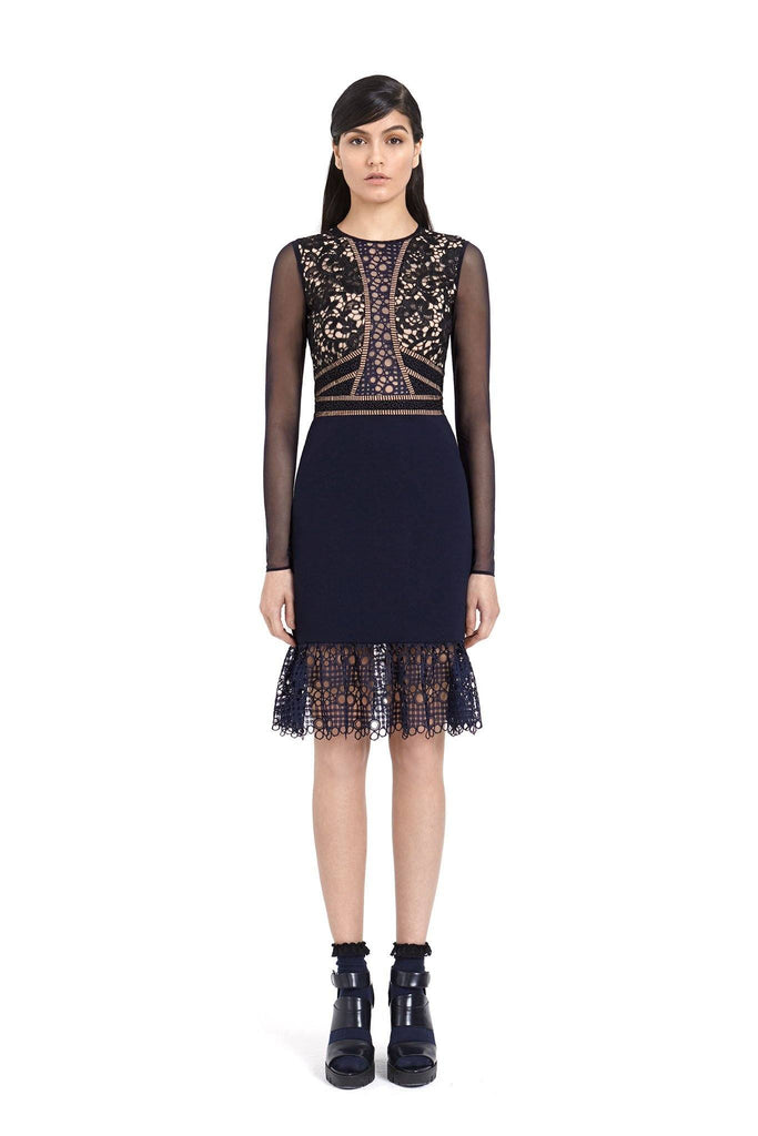 Women's black formal dress with long sleeve lace detail and peplum lace detail at the bottom branded Three Floor at Peek Boutique