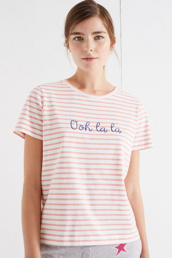 "With the oft-said French exclamation as a slogan to the front, this relaxed-fit ivory cotton t-shirt exudes the flirty mood of the collection. 100% cotton Classic fit, crew neck Made in Portugal Ivory, rose pink stripes, deep sea blue letters Model is 5'10"" and wears a size small"