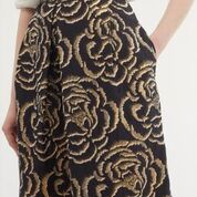 Brocade like gold floral print skirt.  Pair with a pretty shirt or a fitted jumper.