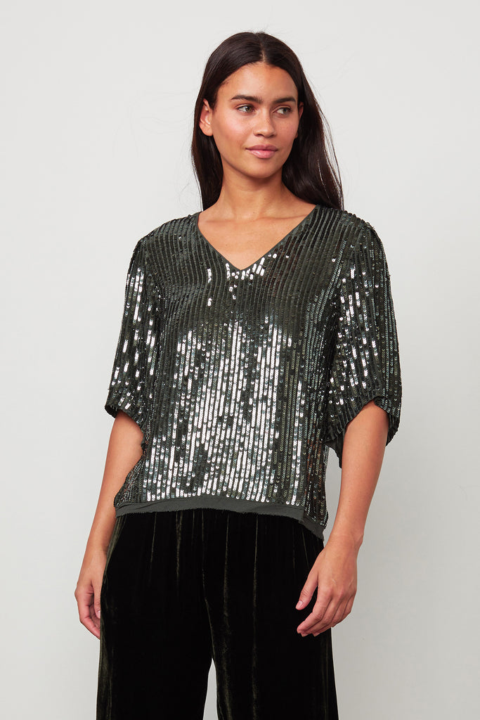 Pretty sparkly top from Velvet by Graham & Spencer.  With a flattering v neck and draping prettily to your waist this will look great with smart trousers, leathers or your favourite denim.