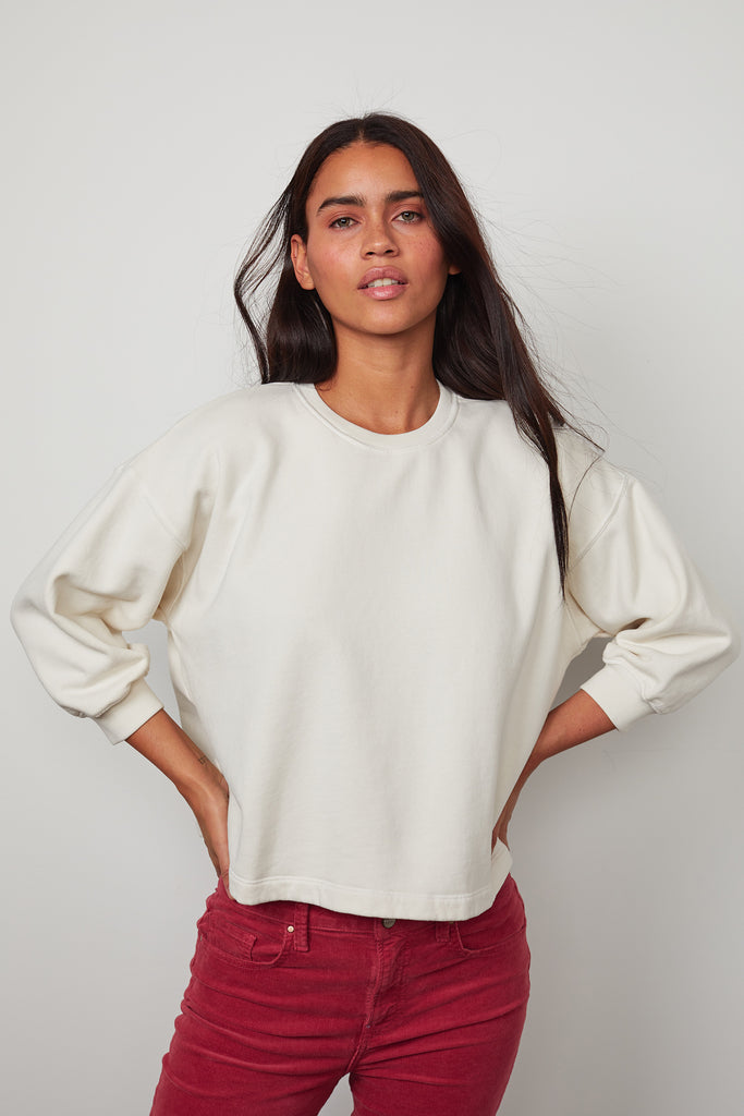 Super soft slightly cropped sweatshirt from Velvet by Graham & Spencer.  This is a perfect shape to wear with your midi skirts but looks great with denim too.